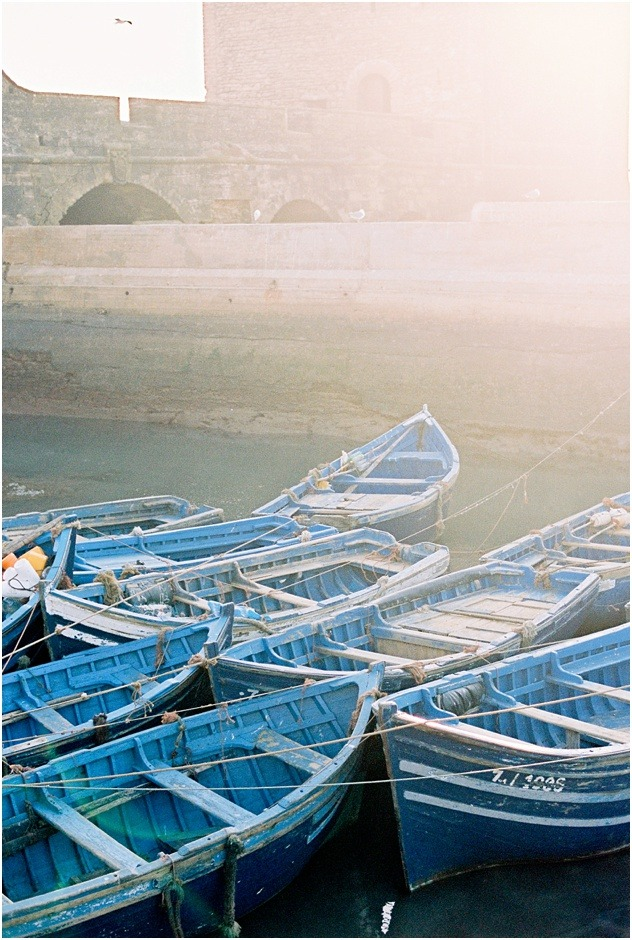 Blue fishing boats at sunset in Essaouira