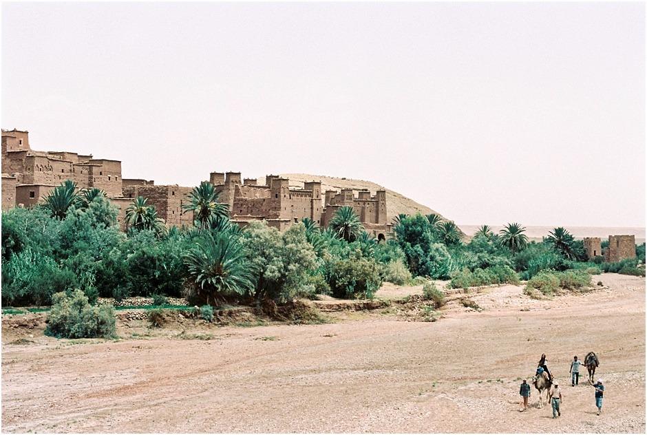Men trekking with camels by Ksar of Ait-Ben-Haddou