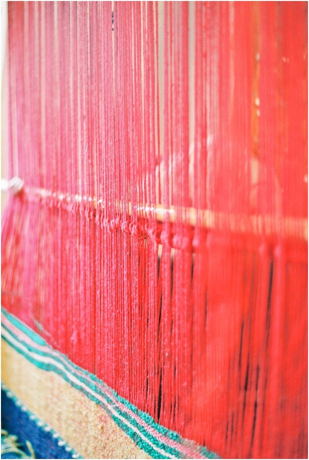 Wool weaving for making carpets in Morocco