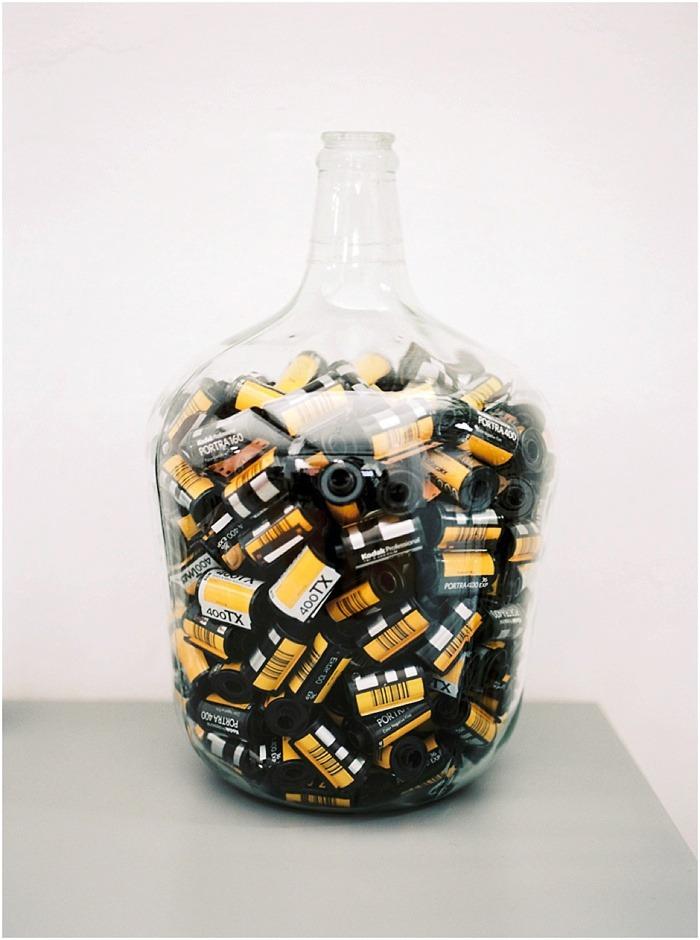 Jar of 35mm film rolls by Fiona Caroline Photography