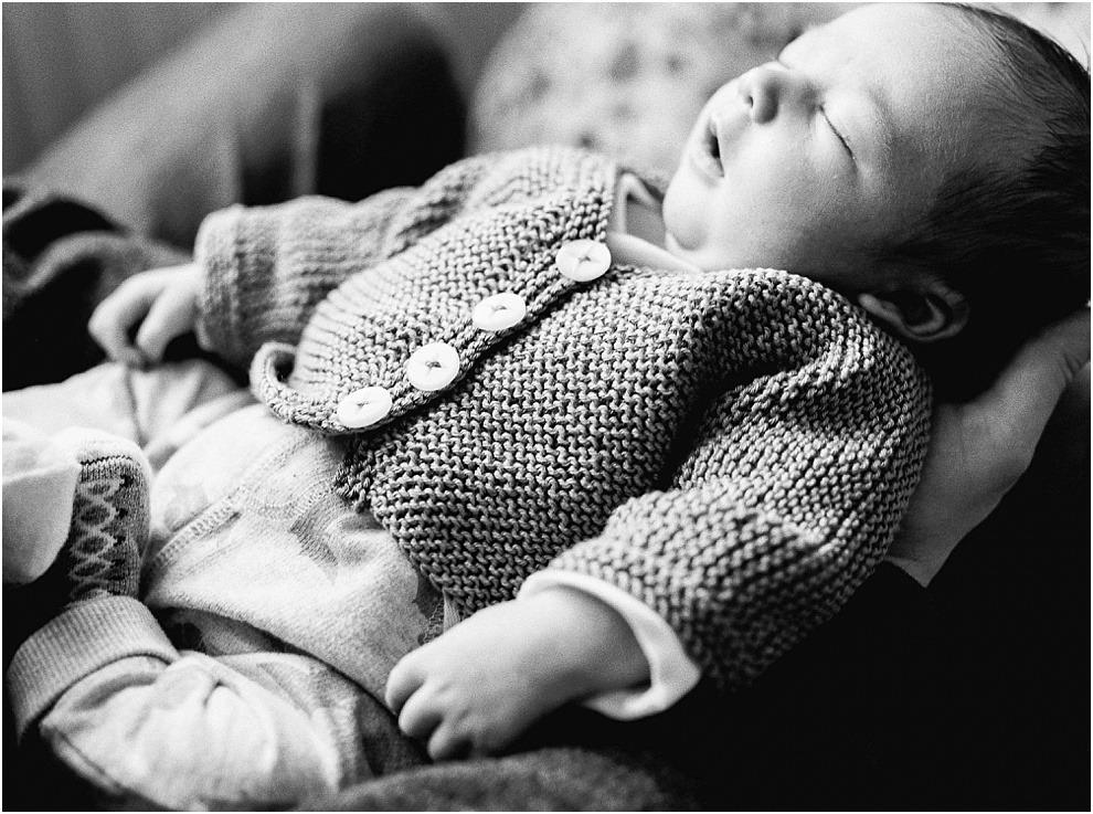 Black and white newborn photograph of baby sleeping.