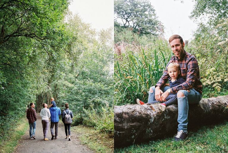 Picture of family walking in to the woods and adult and child relaxing on a felled tree trunk in the woods | Family Woodland Shoot