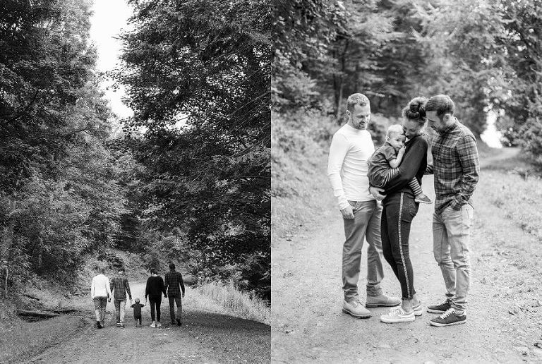 Black and White portaits of family walking into the woods in the distance and cuddling child in a group | Family Woodland Shoot