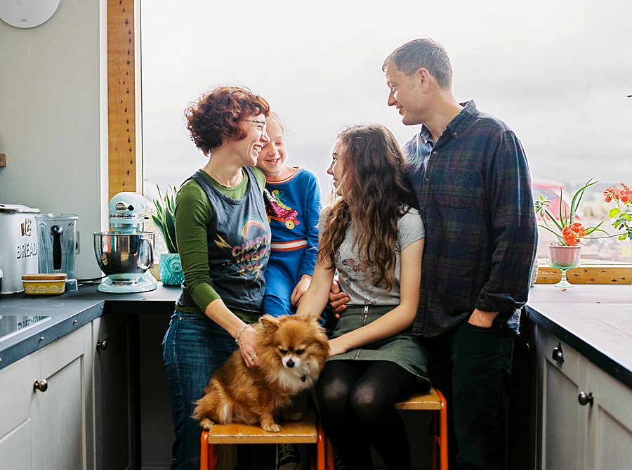 Family and dog laughing together in kitchen | Colour Family Photography