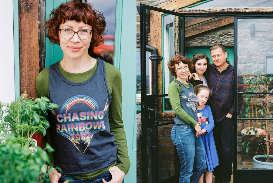 Family Portraits stood outside their home by an open door | Colour family photography